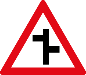 Traffic sign of South Africa: Warning for a crossroad where the roads are not opposite to each other
