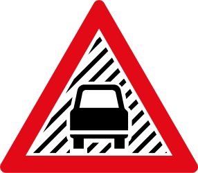 Traffic sign of South Africa: Warning of poor visibility due to rain, fog or snow