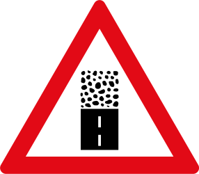 Traffic sign of South Africa: Warning for an unpaved road surface