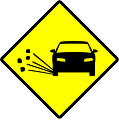 Traffic sign of Indonesia: Warning for loose chippings on the road surface