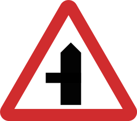 Traffic sign of Nepal: Warning for a crossroad with a side road on the left