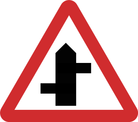 Traffic sign of Nepal: Warning for a crossroad where the roads are not opposite to each other