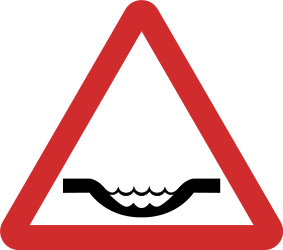 Traffic sign of Nepal: Warning for a dip in the road
