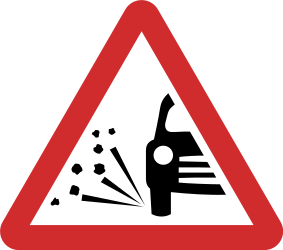 Traffic sign of Nepal: Warning for loose chippings on the road surface