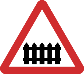 Traffic sign of Nepal: Warning for a railroad crossing with barriers