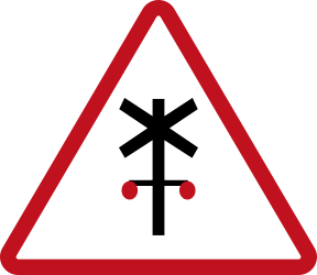 Traffic sign of Philippines: Warning for a railroad crossing with barriers