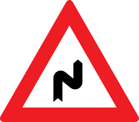 Traffic sign of Austria: Warning for a double curve, first right then left