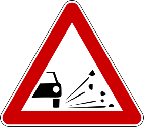 Traffic sign of Bosnia-Herzegovina: Warning for loose chippings on the road surface