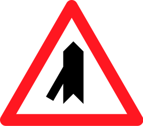 Traffic sign of Switzerland: Warning for a crossroad with a sharp side road on the left