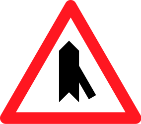 Traffic sign of Switzerland: Warning for a crossroad with a sharp side road on the right