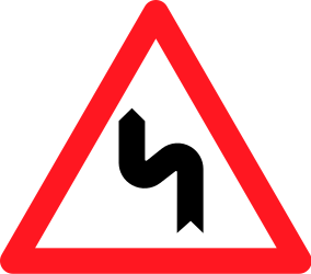 Traffic sign of Switzerland: Warning for a double curve, first left then right