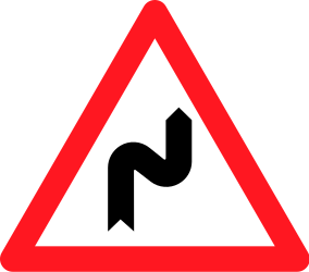 Traffic sign of Switzerland: Warning for a double curve, first right then left