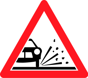 Traffic sign of Switzerland: Warning for loose chippings on the road surface