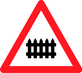 Traffic sign of Switzerland: Warning for a railroad crossing with barriers