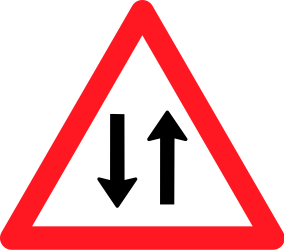 Traffic sign of Switzerland: Warning for a road with two-way traffic