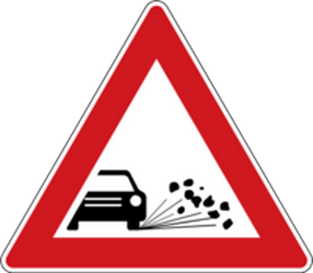Traffic sign of Czech: Warning for loose chippings on the road surface