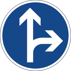 Traffic sign of Germany: Driving straight ahead or turning right mandatory