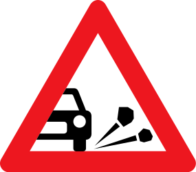 Traffic sign of Denmark: Warning for loose chippings on the road surface
