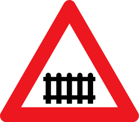 Traffic sign of Denmark: Warning for a railroad crossing with barriers