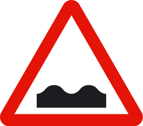 Traffic sign of Spain: Warning for a bad road surface
