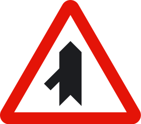 Traffic sign of Spain: Warning for a crossroad with a sharp side road on the left