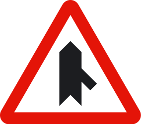 Traffic sign of Spain: Warning for a crossroad with a sharp side road on the right