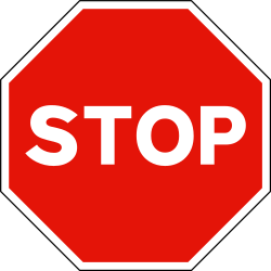 Traffic sign of Spain: Stop and give way to all drivers