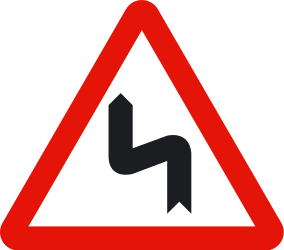 Traffic sign of Spain: Warning for a double curve, first left then right