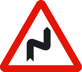Traffic sign of Spain: Warning for a double curve, first right then left