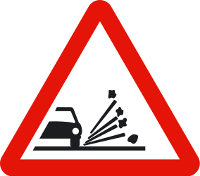 Traffic sign of Spain: Warning for loose chippings on the road surface