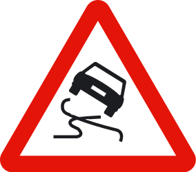 Traffic sign of Spain: Warning for a slippery road surface