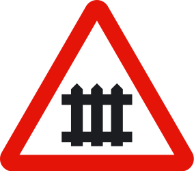 Traffic sign of Spain: Warning for a railroad crossing with barriers