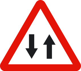 Traffic sign of Spain: Warning for a road with two-way traffic