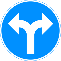 Traffic sign of Finland: Turning left or right mandatory