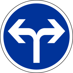 Traffic sign of France: Turning left or right mandatory