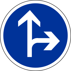 Traffic sign of France: Driving straight ahead or turning right mandatory