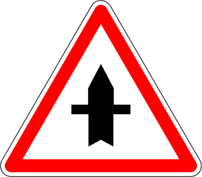 Traffic sign of France: Warning for a crossroad with a side road on the left