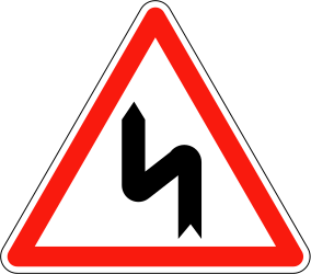 Traffic sign of France: Warning for a double curve, first left then right