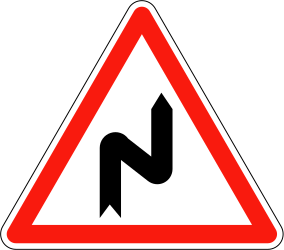 Traffic sign of France: Warning for a double curve, first right then left