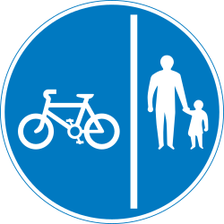 Traffic sign of United Kingdom: Mandatory divided path for pedestrians and cyclists
