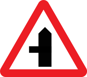 Traffic sign of United Kingdom: Warning for a crossroad with a side road on the left