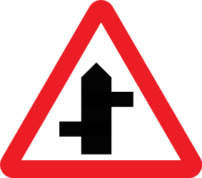 Traffic sign of United Kingdom: Warning for a crossroad where the roads are not opposite to each other