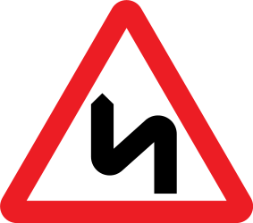 Traffic sign of United Kingdom: Warning for a double curve, first left then right
