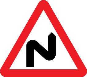 Traffic sign of United Kingdom: Warning for a double curve, first right then left