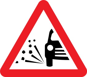 Traffic sign of United Kingdom: Warning for loose chippings on the road surface
