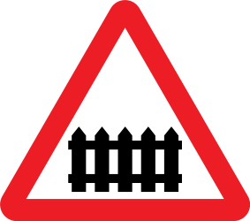 Traffic sign of United Kingdom: Warning for a railroad crossing with barriers