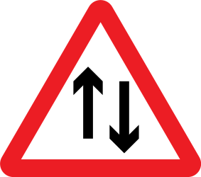 Traffic sign of United Kingdom: Warning for a road with two-way traffic