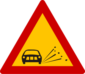 Traffic sign of Greece: Warning for loose chippings on the road surface