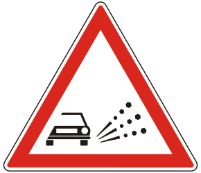 Traffic sign of Hungary: Warning for loose chippings on the road surface