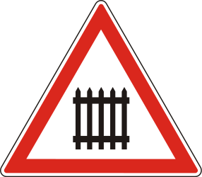 Traffic sign of Hungary: Warning for a railroad crossing with barriers